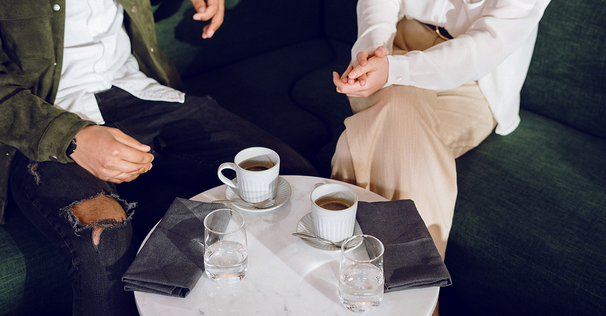 A couple chats over coffee.